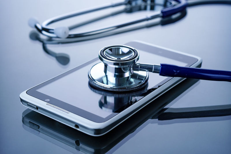 Conceptual image of smartphone being diagnosed with a stethoscope Accuracy Check Up Close-up Conceptual Photography  Diagnose Focus On Foreground Medical Medical; Modern No People Repair Selective Focus Service Smartphone Spiral Stethoscope  Still Life