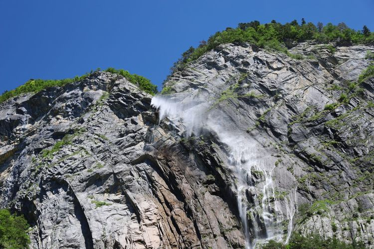 Low angle view of a waterfall through rocks