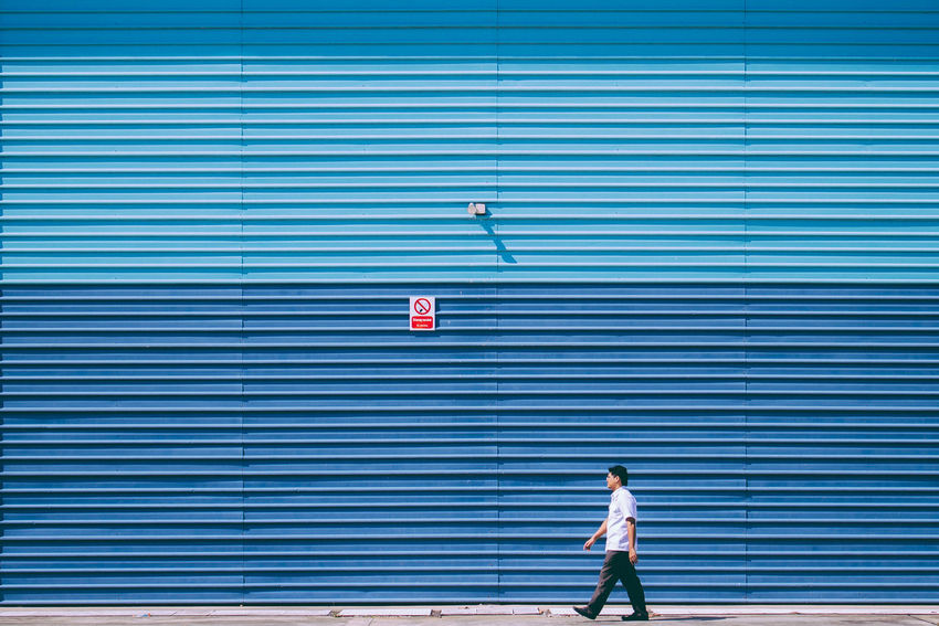 Walk until you can't walk anymore. Alone Backgrounds Blue Minimalism People Symmetry Textured  Walking Around Wall