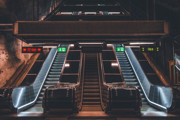 View of illuminated escalator at subway station