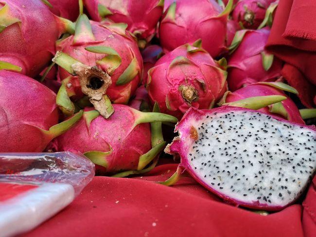 Thai Fruit Famers Market Stalls At Sunday Market Stalls Pink Color Red Fruit Close-up Food And Drink