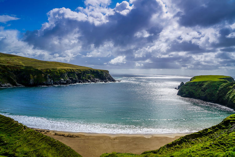 A beautiful crescent shaped beach near Glencolmcille Ireland. Atlantic Ocean Autumn Cliffs Grass Green Ireland Nature Scenic View Beach Clouds Glencolmcille Landscpe Ocean Outdoors Photography Sand Sky Sunshine Water Waves
