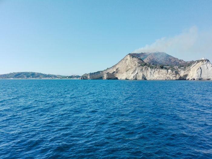 Burning wood in capo miseno, Campanai, Italy Burning Naples, Italy Napoli Blue Burning Wood Campania Capo Miseno Fire Miseno  Mountain Scenics Sea Water