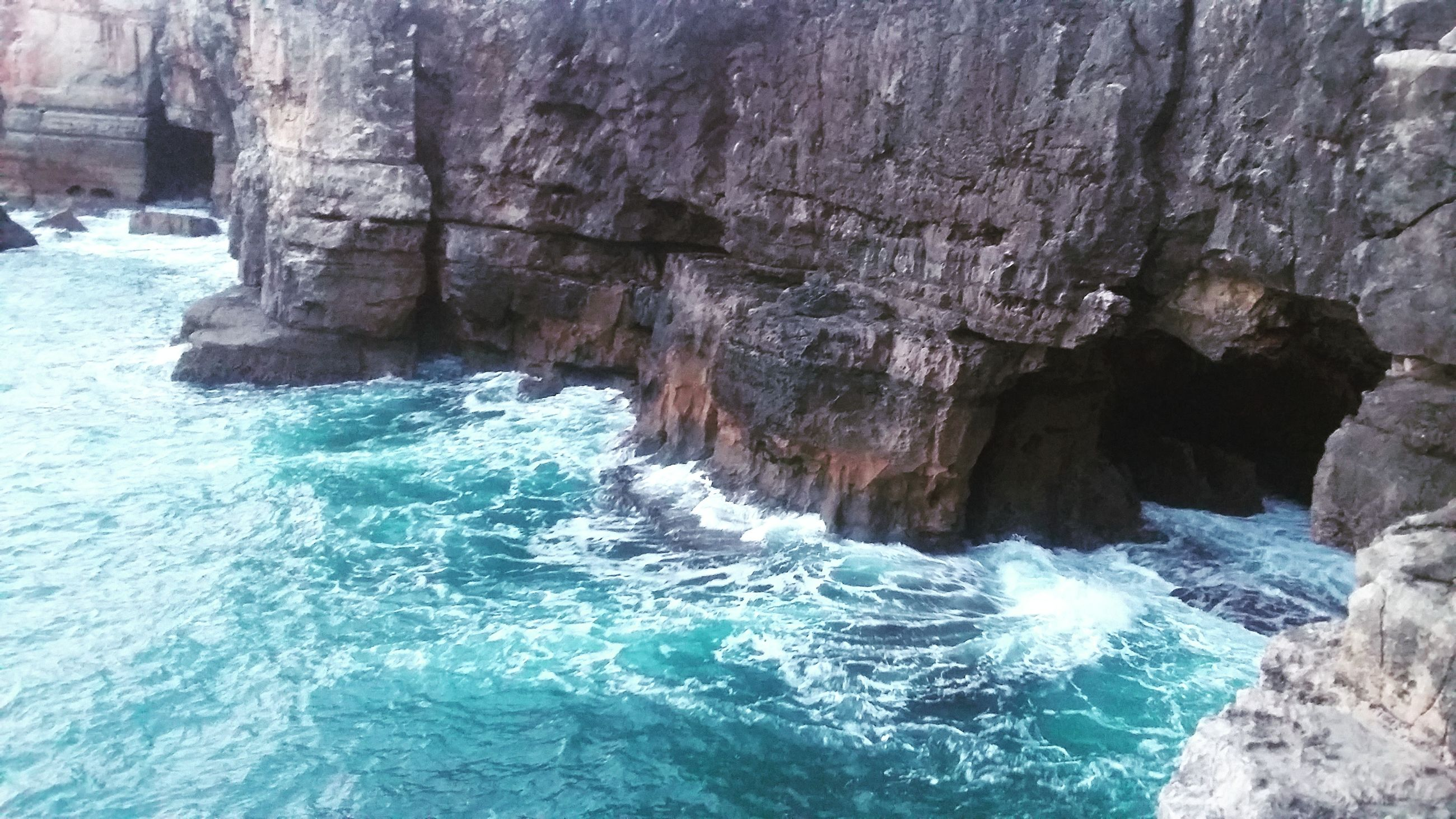 beauty in nature, rock formation, nature, water, rock - object, motion, waterfront, sea, scenics, no people, day, outdoors, power in nature, wave