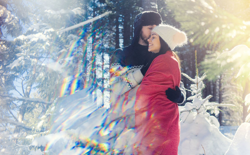 Man and woman in snow during winter