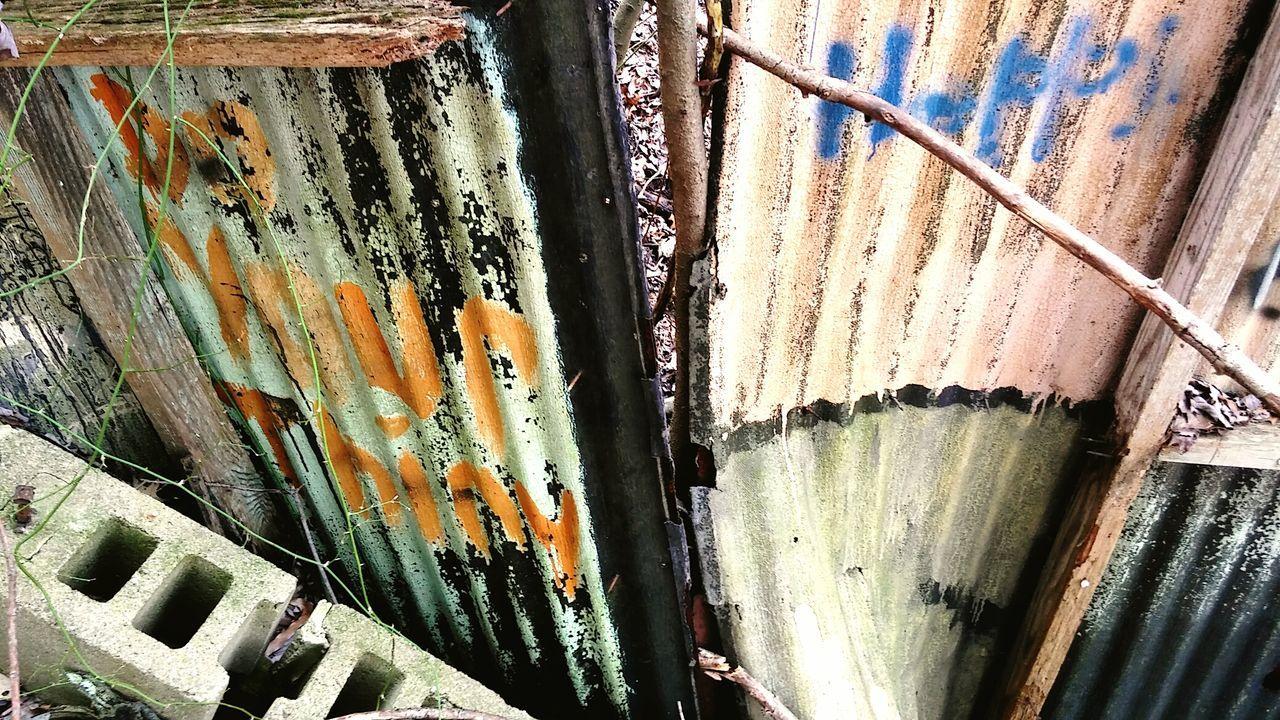 High Angle View Of Graffiti On Metal
