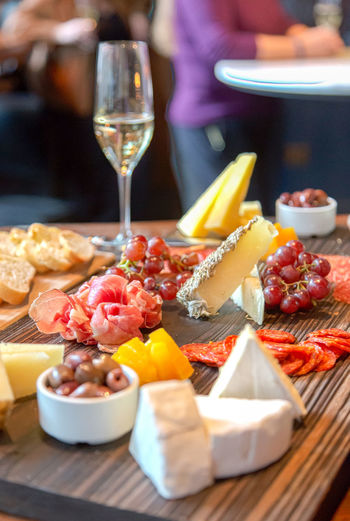 cheese and charcuterie board Champagne Appetizer Brutalism Charcuterie Charcuterie Board Cheese Close-up Day Food Food And Drink Freshness Healthy Eating Indoors  No People Plate Ready-to-eat Serving Size SLICE Table Tapas Wineglass