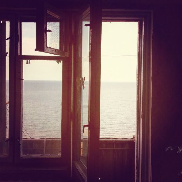 Sea Horizon Over Water Water Window Indoors  Built Structure Day Sky Nature Shore No People Sun
