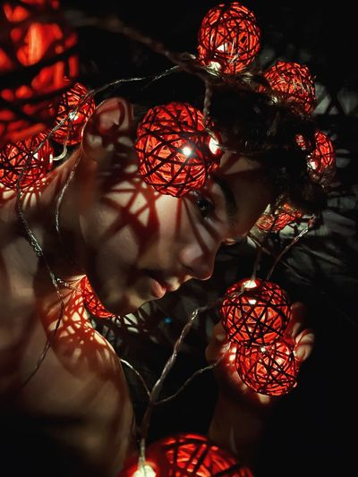 Close-up of woman with christmas decorations
