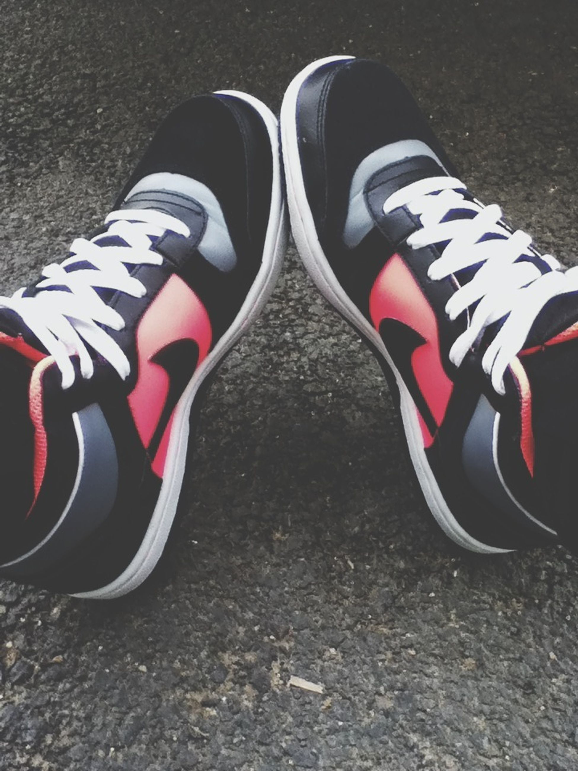 shoe, high angle view, footwear, low section, person, striped, pair, close-up, identity, red, fashion, patriotism, white color, canvas shoe, street, one person, multi colored, shoelace, outdoors, day