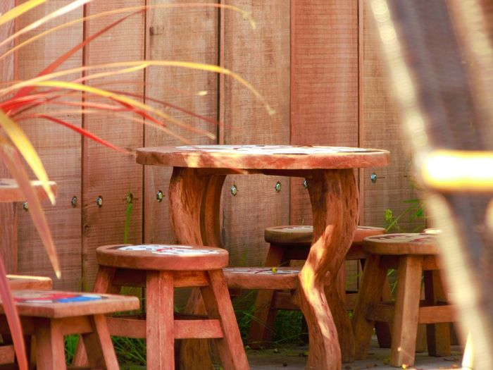 Wood - Material Seat Chair No People Absence Table Empty Day Brown Wood Outdoors Furniture Cafe Built Structure Sunlight Nature Architecture Restaurant Relaxation