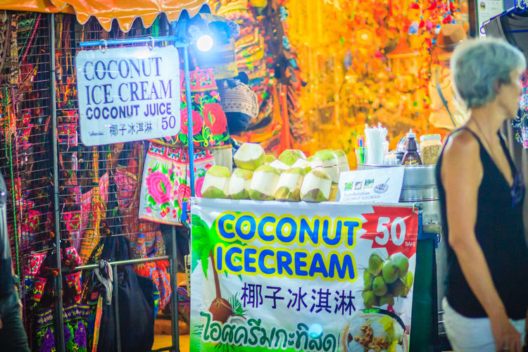 Bangkok, Thailand - March 2, 2017: Street food vendor selling coconut ice cream at Khao San Road night market, Bangkok, Thailand. Coconut Khao San Rd Khao San Road KhaoSan Khaosandroad Street Food Vendors Choice Coconut Ice Cream Communication Day Food And Drink For Sale Ice Cream Khao San Khaosan Road Market Multi Colored Night Market Night Market In Thailand Non-western Script Retail  Retail Display Script Sign Small Business Store Street Food Street Food Market Street Food Of Thailand Street Food Stall Street Food Thailand Street Foods Street Foods Photography Text Variation Western Script