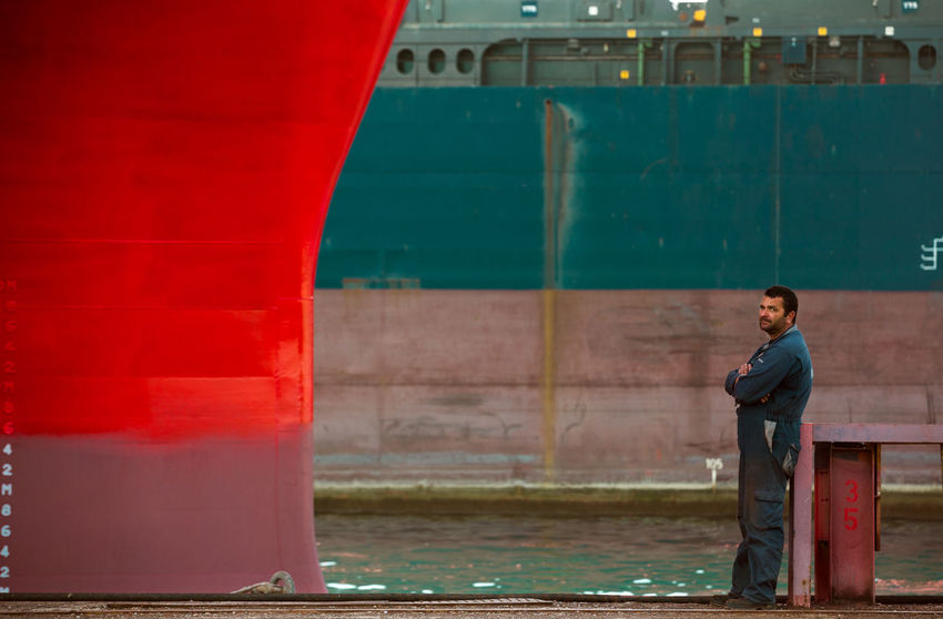 Perama Shipyards/Athens/Greece Architecture Docks Greece, Loutraki Industrial Worker, Industry Ruins Outdoors Perama Perama Shipyards, Red, White And Blue Sea Ship Ships Shipyard Shipyard Worker, Shipyardlife Three Quarter Length Water Worker First Eyeem Photo