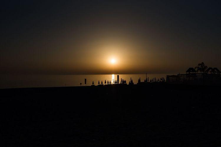 Sunset Water Sky Sea Silhouette Scenics - Nature Sunset Beach Idyllic Holiday Outdoors Sun Nature Tranquil Scene Horizon Over Water Horizon Beauty In Nature