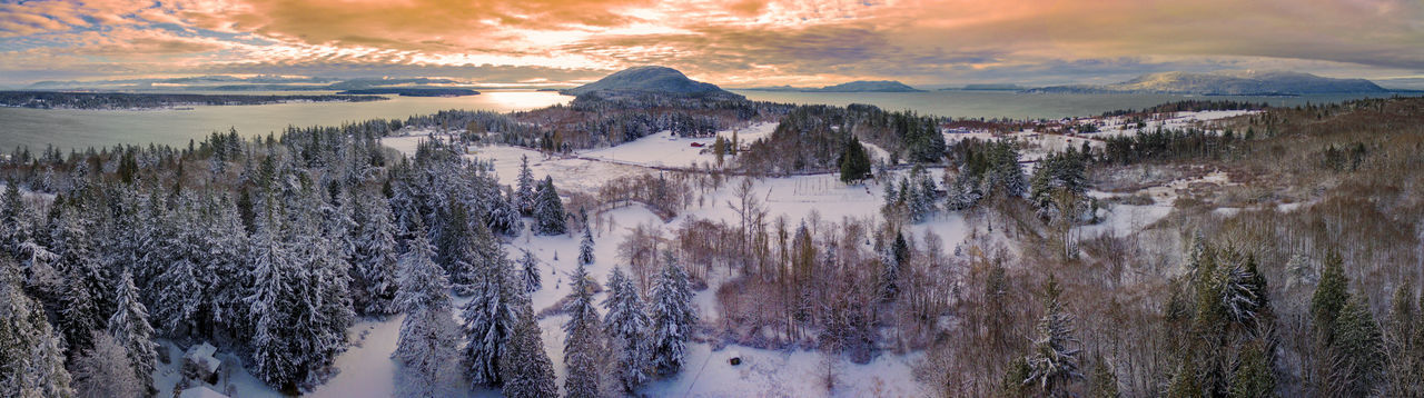 Snow Day on Lummi Island. Aerial view of a rare snowfall in the Puget Sound area of western Washington state. Scenics - Nature Mountain Environment Sky Beauty In Nature Cloud - Sky Snow Tree Cold Temperature Sunset Nature Tranquility Winter Landscape No People Land Water Panoramic Outdoors Lummi Island San Juan Islands Winter Washington State Puget Sound Pacific Northwest