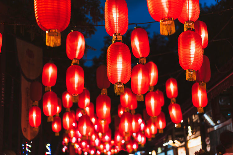 Chinese red lanterns, nightlife China Landscape Blessing Wishing Chinese Culture Lantern Lighting Equipment Hanging Illuminated Chinese Lantern Decoration Red Celebration Night Low Angle View No People Festival Chinese New Year Outdoors