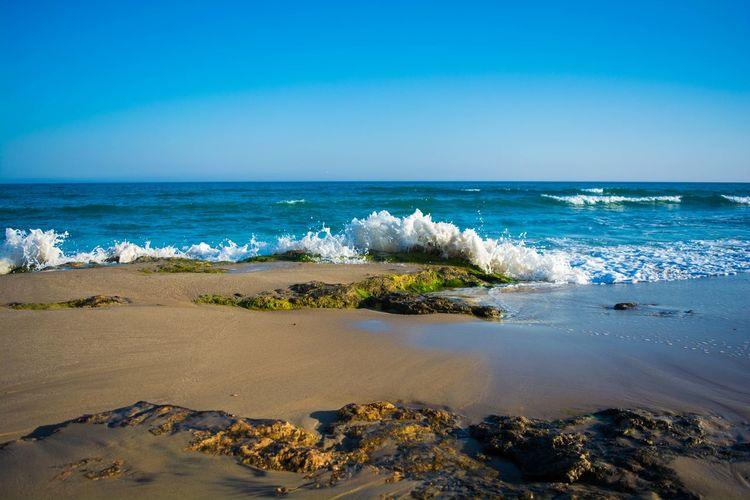 Summer is coming Sea Horizon Over Water Beach Sand Clear Sky Beauty In Nature No People Water Wave Outdoors Blue Rock Seascape Green Sky Nature Tunisie Tunisia