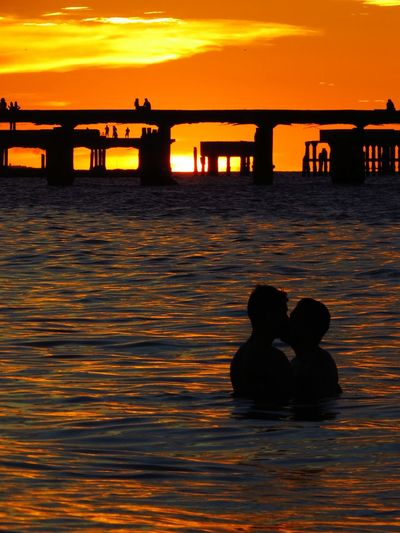 Que poesia... Sunset Silhouette Orange Color Sea Water Beach Sun Reflection People Outdoors Nature Beauty In Nature Sunlight Two People Travel Destinations Love Lgbt Amor