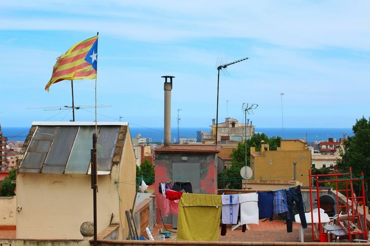 Catalonia Flag Waving On Building Terrace