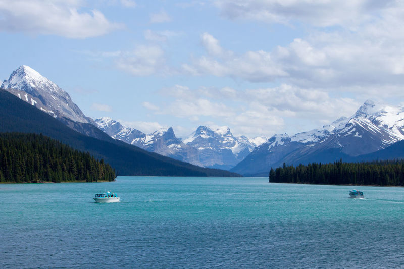 Beauty In Nature Cloud - Sky Cold Temperature Day Environment Ice Landscape Maligne Lake Mountain Mountain Peak Mountain Range Nature Nautical Vessel No People Outdoors Scenics - Nature Sky Snow Snowcapped Mountain Tranquil Scene Tranquility Turquoise Colored Water Winter