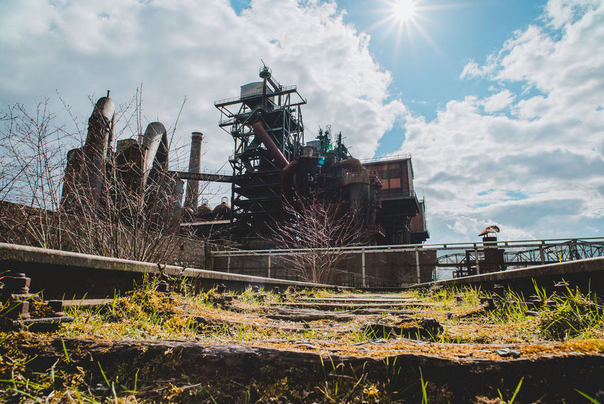 Landschaftspark Nord Abandoned Architecture Bare Tree Built Structure Cloud - Sky Connection Day Field Low Angle View Machinery Metal Nature No People Obsolete Outdoors Plant Sky Sunlight Transportation Tree