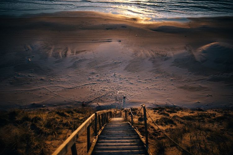 - Sunset at the beach - EyeEm Nature Lover EyeEm Best Shots Nature Outdoors No People Beautiful Sunset Evening Light Sand Dune Sand Sea Beach The Way Forward Scenics Landscape Sunset Beauty In Nature Nature Travel Destinations Outdoors Wood - Material Day No People Footbridge Mountain Sky