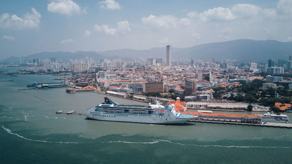 Busy City Cruise Ship Drone  Harbour Malaysia Truly Asia Aerial View Architecture Bird View Blue Built Structure City Cityscape Cruise Harbour City Malaysia Mountain No People Ocean People Sea Sea And Sky Ship Sky Skyscraper Transportation Lost In The Landscape