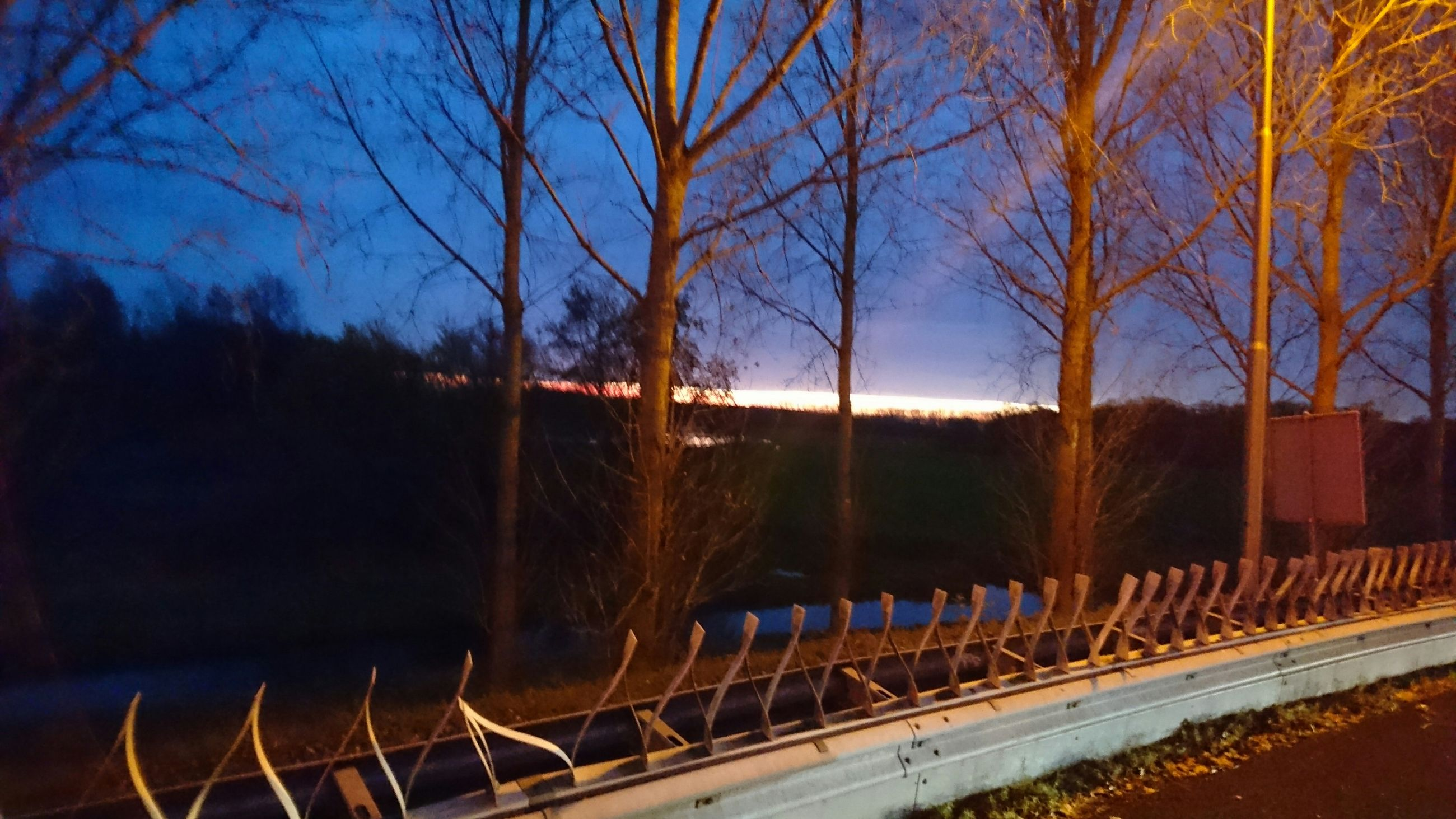 tree, bare tree, sky, railing, transportation, connection, built structure, railroad track, bridge - man made structure, dusk, no people, silhouette, architecture, nature, outdoors, branch, road, tranquility, blue, rail transportation