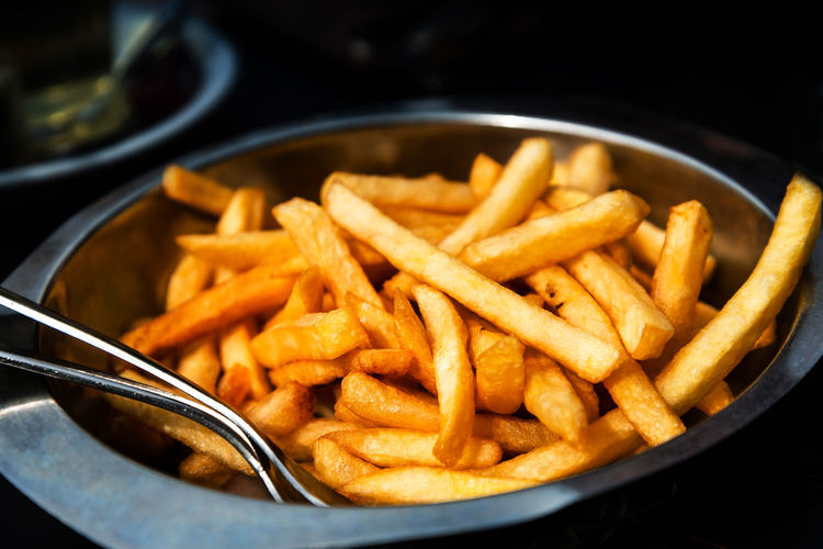 Close-up Comfort Food Delicious Eating Healthy Fast Food Focus On Foreground Food Food And Drink French Fries Freshness Fried High Angle View Household Equipment Indoors  Kitchen Utensil No People Potato Prepared Potato Ready-to-eat Selective Focus Snack Still Life Temptation Unhealthy Eating