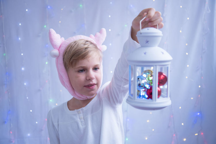 Close-up of girl holding lantern