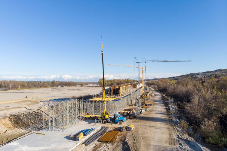 Panoramic shot of construction site against clear blue sky