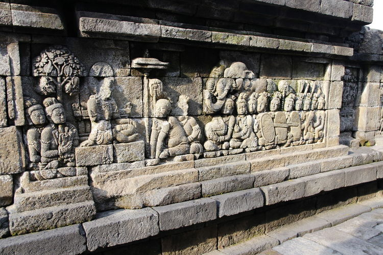 Beautiful bas-relief wall decor carved in stone at Borobudur Temple, Yogyakarta, Indonesia Carvings In Stone INDONESIA Wall Yogyakarta Ancient Ancient Civilization Architecture Art And Craft Bas-relief Belief Borobudur Buddhism Built Structure Carving Carving - Craft Product Craft History Human Representation No People Religion Representation Rocks Sculpture The Past Wall - Building Feature
