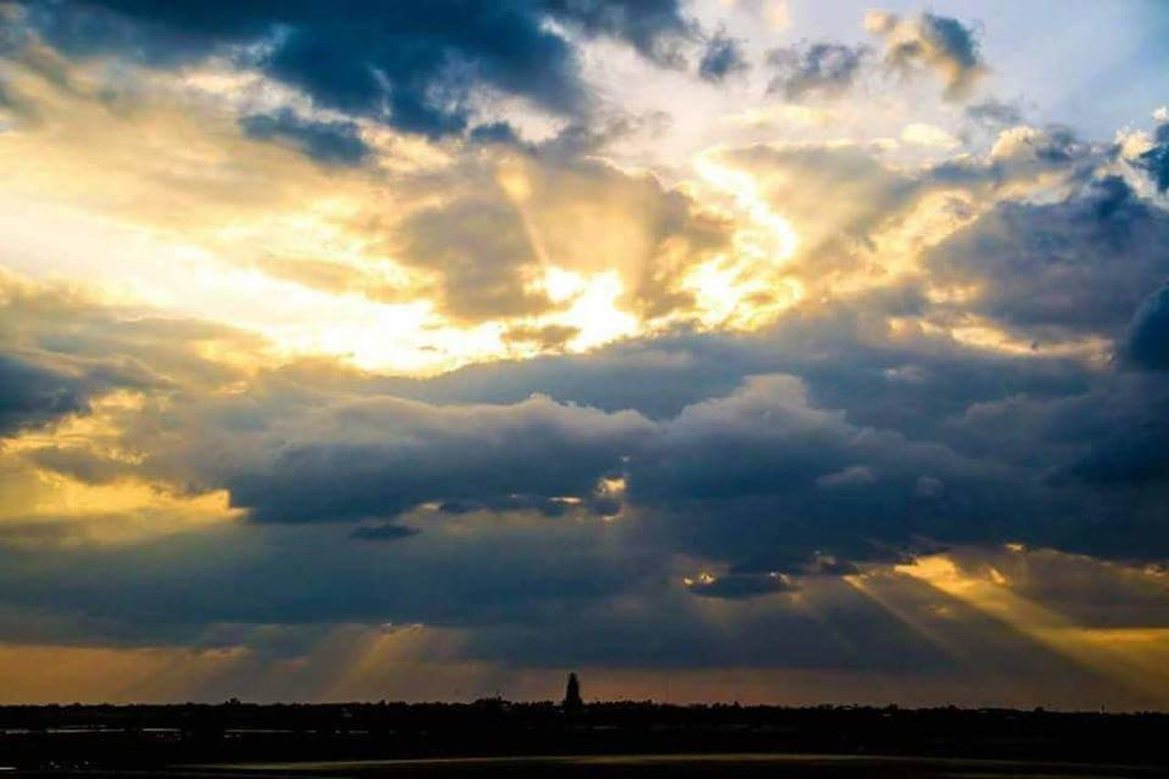 cloud - sky, sky, beauty in nature, scenics - nature, sunset, nature, environment, tranquil scene, tranquility, no people, landscape, outdoors, cloudscape, silhouette, horizon, storm, sunlight, dramatic sky, idyllic, ominous