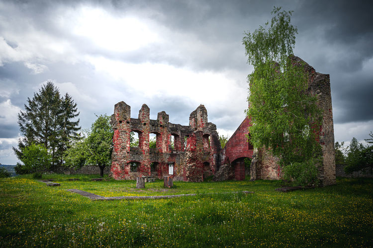 View of old ruin building in field