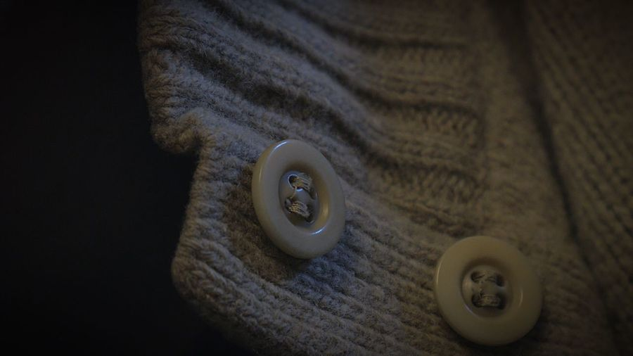 Close-Up Of Buttons On Sweater