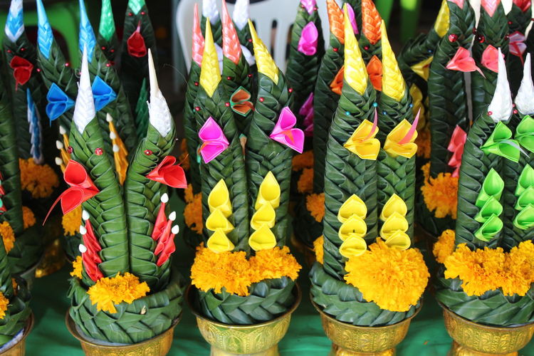 Close-up of multi colored flowers for sale at market stall