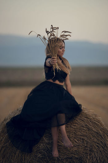 Dress Widow Beautiful Woman Black Blond Hair Cereal Plant Day Focus On Foreground Front View Full Length Headdress Leisure Activity Lifestyles Nature One Person Outdoors People Performance Portrait Real People Sky Young Adult Young Women