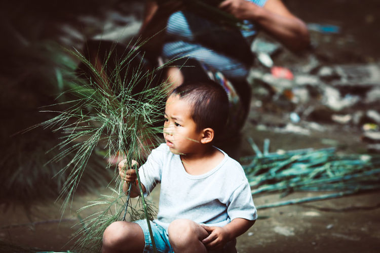 local Culture Childhood Real People Child Innocence Lifestyles Casual Clothing Leisure Activity Cute People Males  Baby Focus On Foreground Men Toddler  Front View Young Three Quarter Length Boys Outdoors