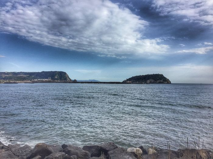 Io voglio il mare Water Sky Sea Cloud - Sky Scenics - Nature Beauty In Nature Beach Tranquility Tranquil Scene Solid Land Rock - Object No People Outdoors Nature Pebble Rock Horizon Day Idyllic
