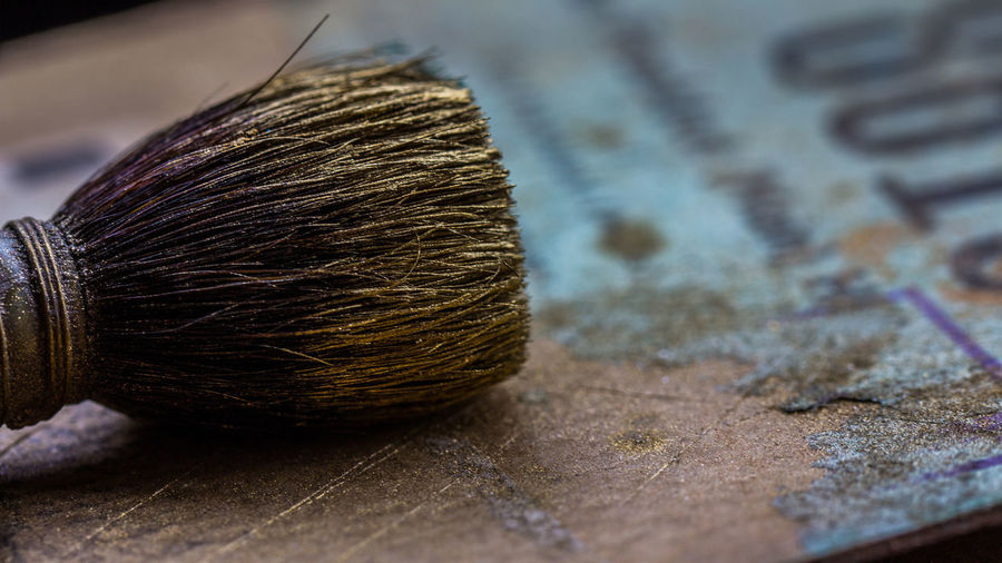 Close-up of brush on table