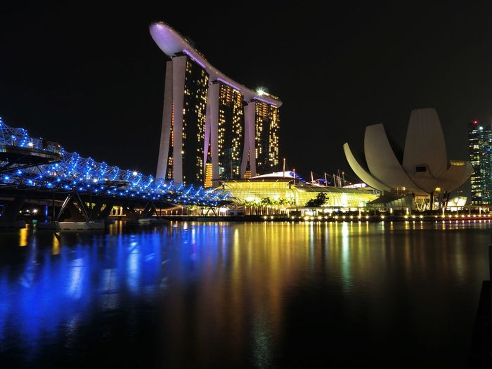 Illuminated marina bay sands and artscience museum at night