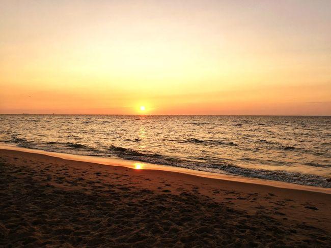 Sunset Sea Beach Sand Scenics Horizon Over Water Nature Beauty In Nature Outdoors