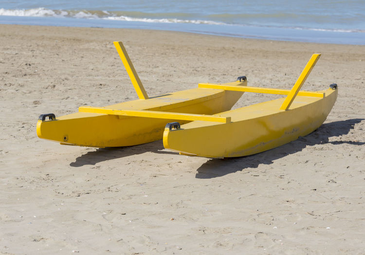Rescue Boat on the Beach Mediterranean  Mediterranean Sea Sunny Beach Boat Color Day Nature Nautical Vessel No People Oar Outdoors Rescue Boat Sand Sea Shore Water Yellow