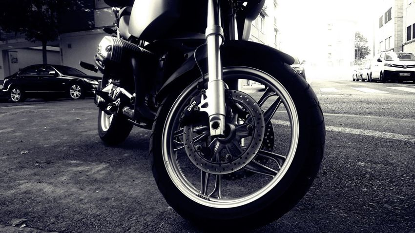 Motorcycle Wheel Black And White Blackandwhite Car City Day Footpath Land Vehicle Low Section Metal Mode Of Transportation Monochrome Motor Vehicle Motorbike Outdoors Road Silver Colored Stationary Street Tire Transportation Travel Wheel