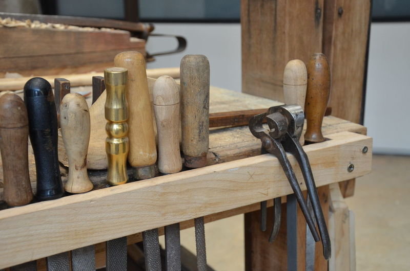 Close-up of tools on table in workshop