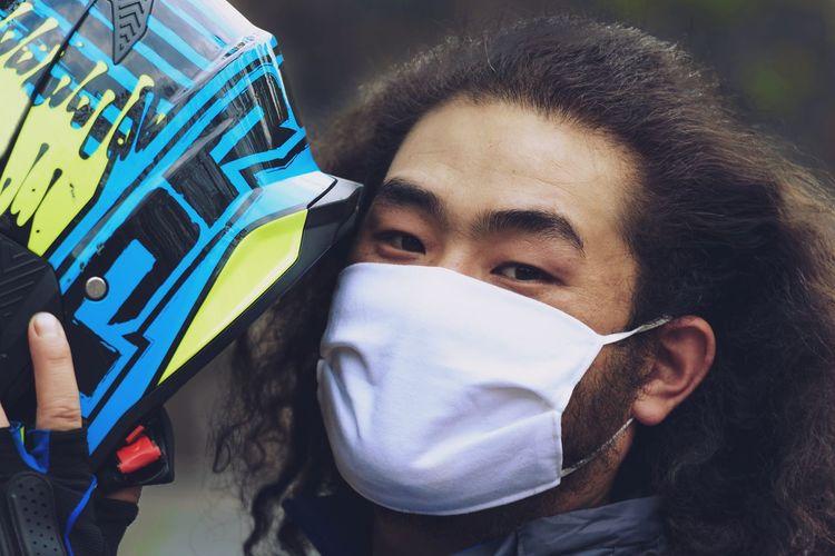 Portrait of man wearing helmet