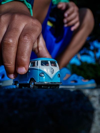 Little, Big Baby Vw Camper Van VW Bus Foreground Lumix Streetphotography Compositionkillerz Human Hand Hand Human Body Part Real People One Person Human Finger Finger Body Part Car Lifestyles Close-up Holding Toy Blue Focus On Foreground Childhood Day Motor Vehicle Leisure Activity Teenager A New Perspective On Life EyeEmNewHere Human Connection Holiday Moments EyeEmNewHere Moments Of Happiness