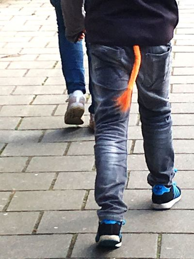 Koningsdag (King's Day) Amsterdam orange lion's tale Low Section Jeans Human Leg Standing Walking Casual Clothing Day Real People Trousers Shoe One Person Boy Outdoors People Break The Mold