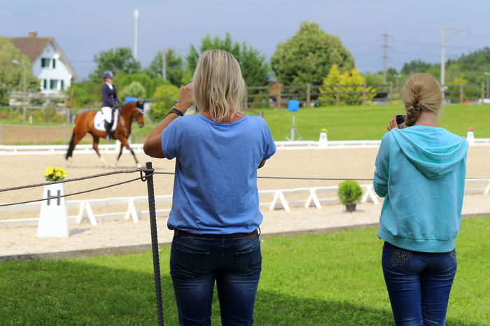 Filming spectators at dressage competition. Audience Blue Casual Clothing Competition Competitive Sport Concentration Devotion Dressage Dressage Competition Equestrian Eye4photography  EyeEm Best Shots Filming Friendship Horse Jeans Leisure Activity People Real People Rear View Rider Spectators Sports Summer Togetherness