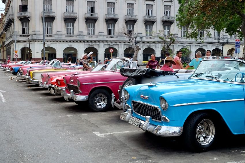 Classic American cars serve as taxis in Havana, Cuba. Havana Cuba Architecture Mode Of Transport Building Exterior Vintage Car Street Built Structure City Land Vehicle Outdoors Classic Carribean Men Day Adult People Fujifilm_xseries Fujifilm Mobility In Mega Cities